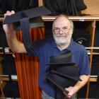 A Graduate Women Otago regalia convener, Walter Lawrence, holds trenchers as preparations...