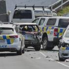 A police photographer takes photos at the scene of a car crash which left a police dog injured...
