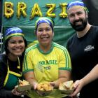 Brazilians (from left) Nathalia Paiva, Elisangela Oliveira Pont and Thiago Sa cooked some snacks...