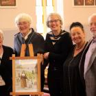 Celebrating the unveiling of a portrait of St Mary MacKillop at St Mary Star of the Sea church at...