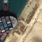 The Ever Given became wedged diagonally across a southern section of the Suez Canal amid high...