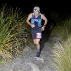 Chris Bisley runs through the dark on the way to winning the Three Peaks Plus One Mountain Race...