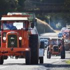 Steve Day leads the way for the Heartland Tractor Trek on the Dunedin Northern Motorway yesterday...