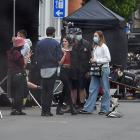 American actress and singer Laura Marano (third from right) takes a break between takes on the...