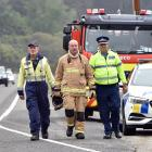 Waitati firefighter Andy Beecroft, senior firefighter Craig Meade, and Inspector Craig Brown are...
