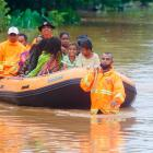 Rescue workers evacuate people in an area affected by floods in Dili, East Timor, at the weekend....
