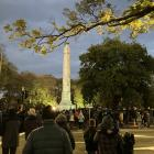People gather around the cenotaph in Queens Gardens this morning for the Dunedin Dawn Service....