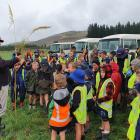 Anama farmer Michael Rushton talks to Mayfield School pupils about the planting of 200 flaxes and...