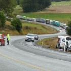 Police review the scene of a three-car crash on State Highway 1 near Lovells Flat yesterday...