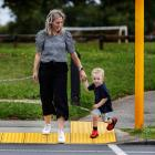 Bodie Hamilton about to cross at the signalled crossing near his home, with mum, Hayley. Despite...