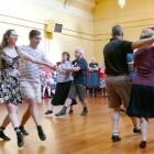 A group of dancers illustrates a teaching sequence during the Royal Scottish Country Dance...