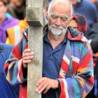 Stephen Macey, of Mosgiel, leads a group of about 30 people from church communities across the...