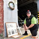 Ex-serviceman Chris Kitto pays his respects to fallen servicemen at the Go Bus depot, in Princes...
