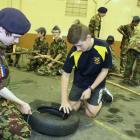 City of Dunedin Cadet Unit cadet Hunter MacDade (14, left) works with  Aaron Stoddart (15), of...