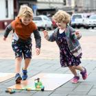Siblings Liam (5) and Billie (3) Tucker, of Dunedin, take part in ''Corona Bowling'', during...