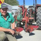 Matt Ridge uses a preloved 1980 Kverneland conventional two farrow plough drawn by his Massey...