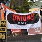 Dunedin bus passenger Umi Asaka (left), Unite Union organiser Sonja Mitchell and part-time bus...