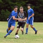 Mosgiel's Rahan Ali (left) looks to get past Northern's Harry Fraser while Rahan's brother Kasam...