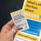 The Ministry of Health's exemption card pictured with the flyer by Billy Te Kahika's group The...
