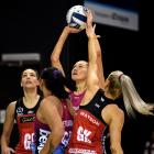 Steel goal shooter George Fisher prepares to shoot while Tactix defenders Karin Burger (left) and...