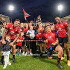 Codie Taylor, Tamaiti Williams and Manasa Mataele with fans after their win over the Blues at...