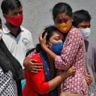 A woman is consoled after her husband died due to Covid-19 in Ahmedabad, India. Photo: Reuters