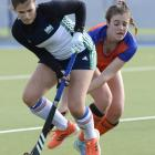 Disputing possession in a match at the McMillan Hockey Centre are Maddie Peel (left) of King's...