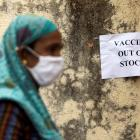 A notice about the shortage of coronavirus disease (COVID-19) vaccine supplies is seen at a...