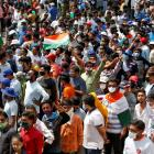 Fans line up to attend an IPL game. Photo: Reuters