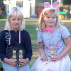 Kakanui School pupils Tilly McKnight (left) and Kate Ransby(both 7) hold some of the Easter...
