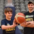 Otago Nuggets supporter Charlie Bauchop (14) passes a ball at the Edgar Centre this week as...
