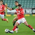 Dylan Pierias of Western United contests the ball from Tim Payne of the Wellington Phoenix during...