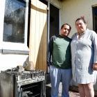 Elkin and Luisa Buitron outside their now uninhabitable Invercargill home. Photos: Laura Smith