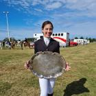 Payton Downs (11), of Outram, receives the Kirkland Trophy on behalf of West Taieri Pony Club....
