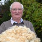 New Zealand Wool Classers Association executive officer Bruce Abbott, of Mosgiel, displays...