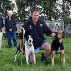 Kauana Sheep Dog Trial Club member Rod Coulter pats his heading dog Blue and huntaway Bruce, as...