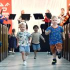Big fans of Beethoven and running around churches (from left) Jimmy Burke (3), Oscar Muir (3) and...