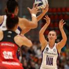 Northern Stars wing attack Gina Crampton feeds the ball into the circle during her 100th ANZ...