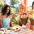 Michelle Obama talks to Mochi (centre) and Waffles during an episode of children's cooking show...