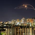 Israel's Iron Dome anti-missile system intercepts rockets launched from the Gaza Strip towards...