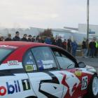 Drivers, pit crew and officials gather in foggy conditions to form a guard of honour as Shayne...