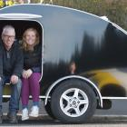 Dave Carrick with the teardrop caravan he helped build for his daughter, Amy Carrick. Photo:...