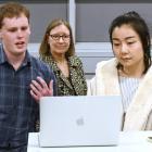Matthew Chilcott (left) and Jean Li present their hackathon idea (via computer) to a panel of...