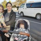 Lauren Stevenson with her children Mia, 2, and Kiri, 6 months, at the Prebbleton crossing. Photo:...