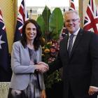 New Zealand Prime Minister Jacinda Ardern poses with Australian Prime Minister Scott Morrison...