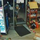 A person disguised in a creepy mask busts through the front door of Sunvue Dairy in Glen Eden on...