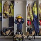 Hoping that he will one day grow into a firefighter's outfit is Ray Wilson, of Mosgiel, at the...