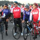 Sir John Kirwan (second from left) hands out the lollies at the second to last stop on the...