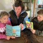Lucia (9) and Benson (11) are collaborating with their father, Tim Boys, to write the next books...