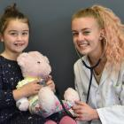 Ariana Kristel (6) holds her teddy  Cookie for a check-up by medical student Alice Ihaka at the...